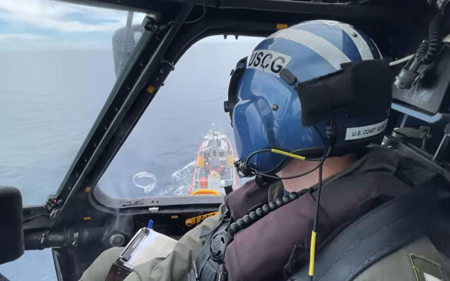 A Coast Guard helicopter from the Clearwater air station flies a rescue mission on July 1, 2021.