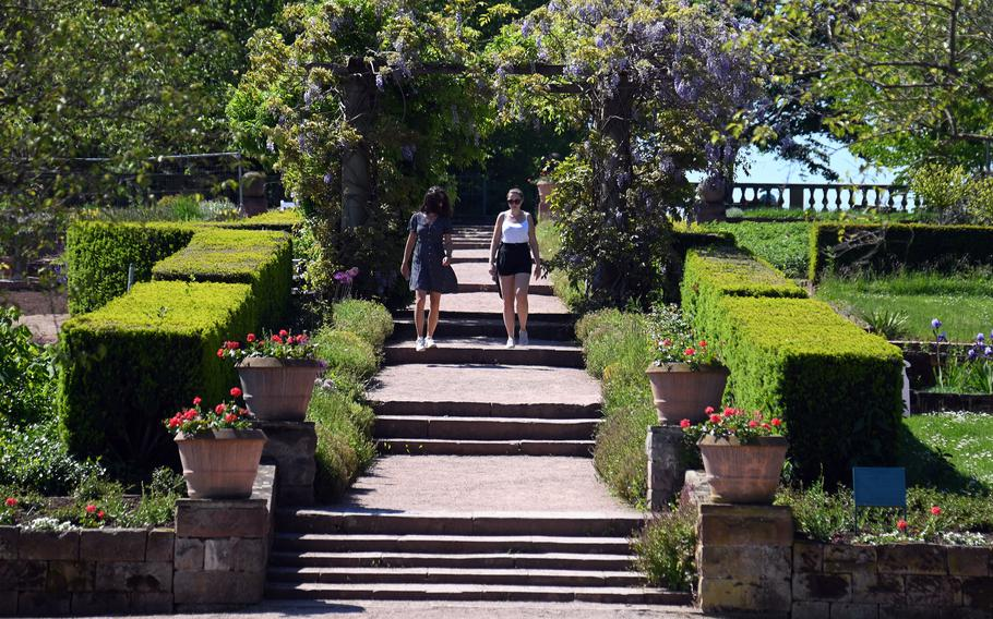 Two visitors to Rosenhoehe Park in Darmstadt, Germany, walk through the Rosarium. The park, on the eastern end of the city, was founded by Grand Duchess Wilhelmine of Hesse at the beginning of the 19th century.