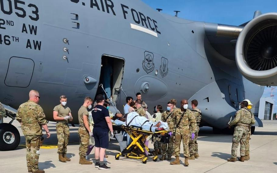 Airmen from the 86thMedical Group help an Afghan mother and family off a U.S. Air Force C-17, call sign Reach 828, moments after she delivered a child aboard the aircraft upon landing at Ramstein Air Base, Germany, Aug. 21, 2021.