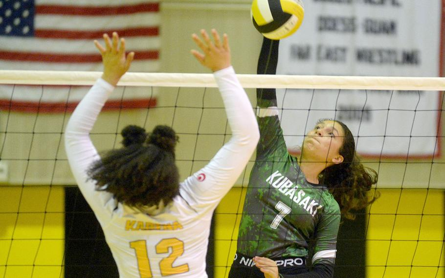 Kubasaki's Sophia Grubbs spikes past Kadena's Malana Williams during Tuesday's Okinawa volleyball match. The Dragons beat the Panthers in straight sets for the fifth time this season.