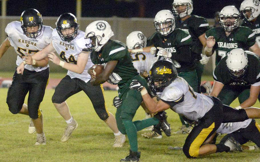 Kubasaki running back Godfrey Wray gets chased down by Kadena's Joey Puterbaugh, Andrew Vessely and Conner Burgess.