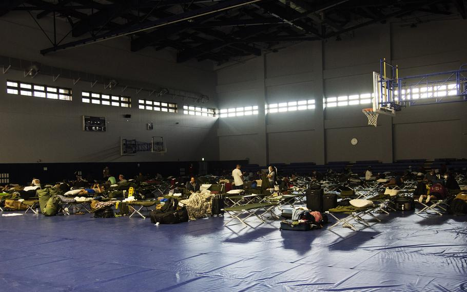 Many delayed Patriot Express passengers slept on cots inside a gym at Marine Corps Air Station Iwakuni, Japan, after a hard landing on Tuesday, July 13, 2021, forced their flight to return to Tokyo for repairs.