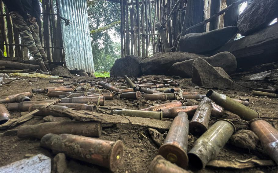 Spent bullet casings lie scattered on the ground in a hut near the village of Chenna Teklehaymanot, in the Amhara region of northern Ethiopia Thursday, Sept. 9, 2021.