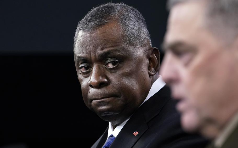 Defense Secretary Lloyd Austin, left, listens as Chairman of the Joint Chiefs of Staff Gen. Mark Milley, right, speaks during a briefing at the Pentagon in Washington on Thursday, May 6, 2021.