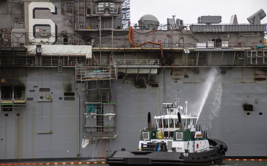 Sailors and firefighters combat a blaze aboard the amphibious assault ship USS Bonhomme Richard at Naval Base San Diego, July 14, 2020.