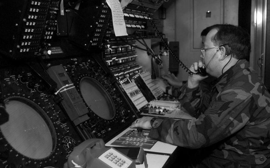Taszar AB, Hungary, January, 1996: Air Force reservists guide incoming aircraft to Taszar's landing strip during initial stages of Operation Joint Endeavor.