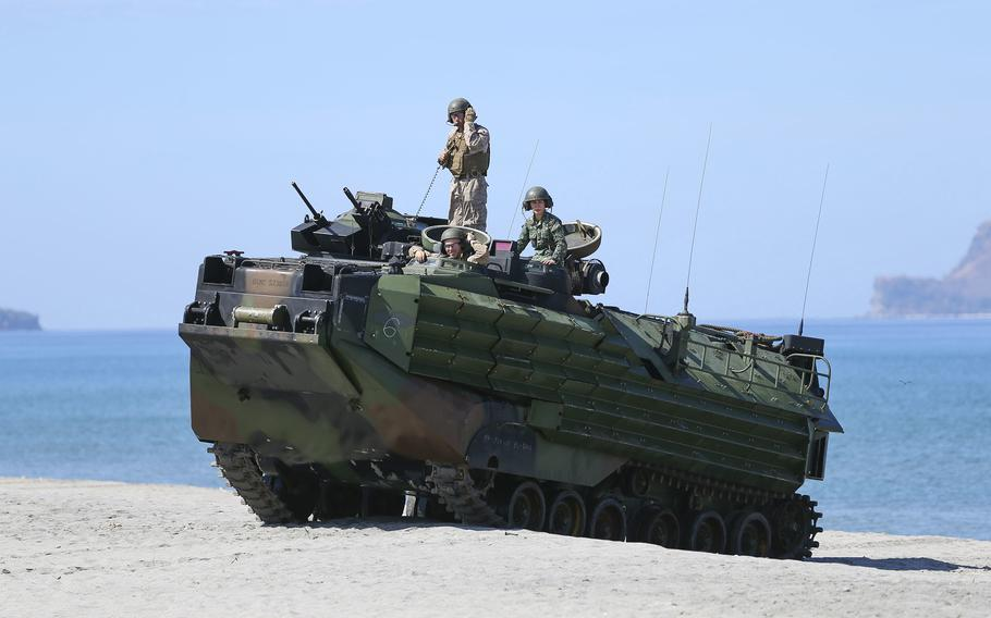 U.S. and Philippine marines land on a beach in an assault amphibious vehicle during an Exercise Balikatan drill in Zambales, Philippines, April 3, 2019.