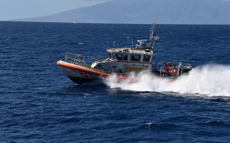 A Coast Guard Response Boat-Medium crew conducts search patterns by water during a search and rescue exercise near Kapalua, Maui, Oct. 24, 2019.