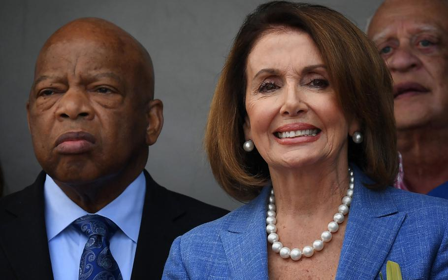 Rep. Nancy Pelosi (D-California), right, stands with civil rights icon, Rep. John Lewis (D-Georgia), left, during a rally in Los Angeles on April 9, 2017.