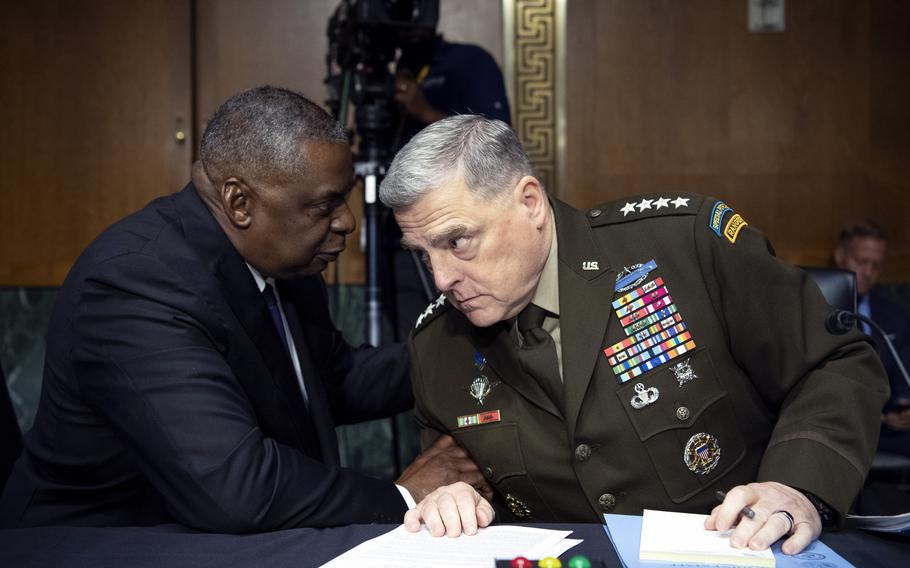Defense Secretary Lloyd Austin, left, and Army Gen. Mark Milley, chairman of the Joint Chiefs of Staff, talk before a Senate Appropriations Committee hearing to examine proposed budget estimates and justification for fiscal year 2022 for the Defense Department in Washington on Thursday, June 17, 2021.