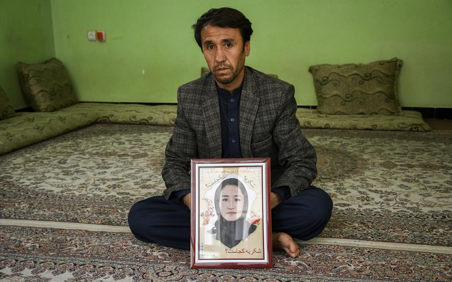 Abdullah Ahmadi holds a picture of his daughter Shukria, 18, on May 31, 2021. Shukria has been missing since a bombing killed at least 85 students at a girls' school in western Kabul, Afghanistan on May 8, 2021.