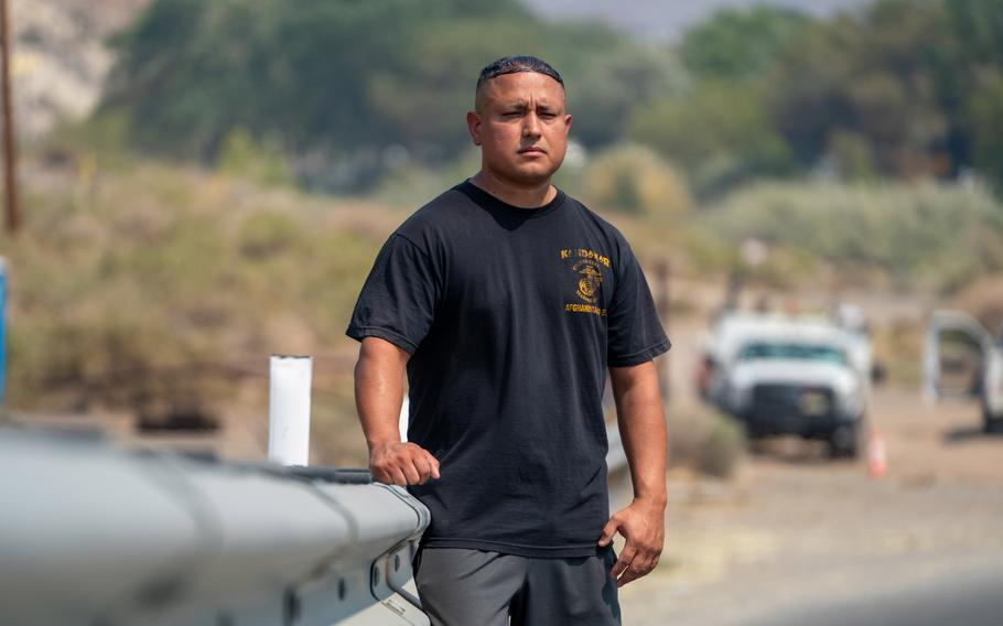 Stephen Lara poses along a Nevada highway where law enforcement seized nearly $87,000 from him in February — without alleging any crimes.