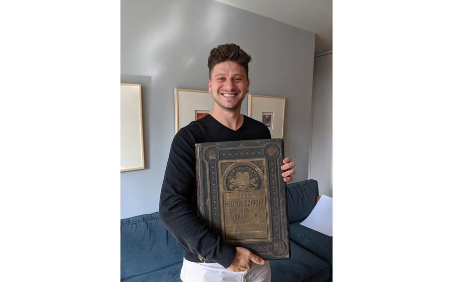 Jacob Leiter holds the Bible belonging to his great-great-grandparents.