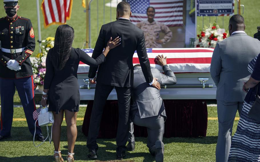 Mourners pay their respects to Sgt. Johanny Rosario Pichardo, a U.S. Marine who was among 13 service members killed in a suicide bombing in Afghanistan, during a public wake in her hometown of Lawrence, Mass., Tuesday, Sept. 14, 2021.