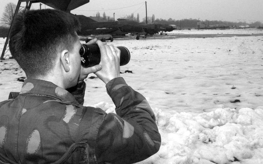 Taszar AB, Hungary, January, 1996: A Hungarian airman scopes out the sites while standing guard at Taszar AB.