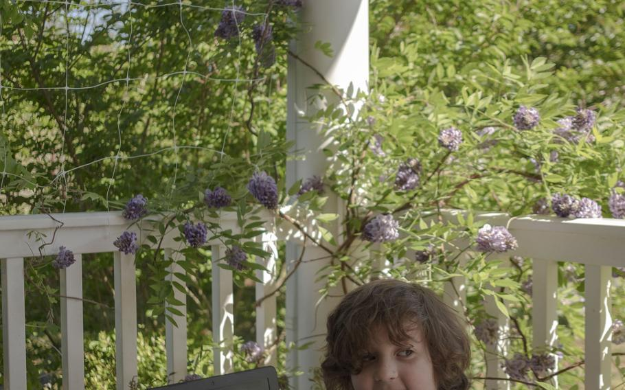 Robert, 6, attends virtual school on the deck of his home in Fredericksburg.
