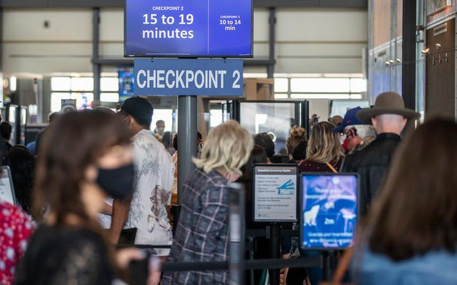 Travelers wait to go through security checkpoints at Austin-Bergstrom International Airport on May 28, 2021.