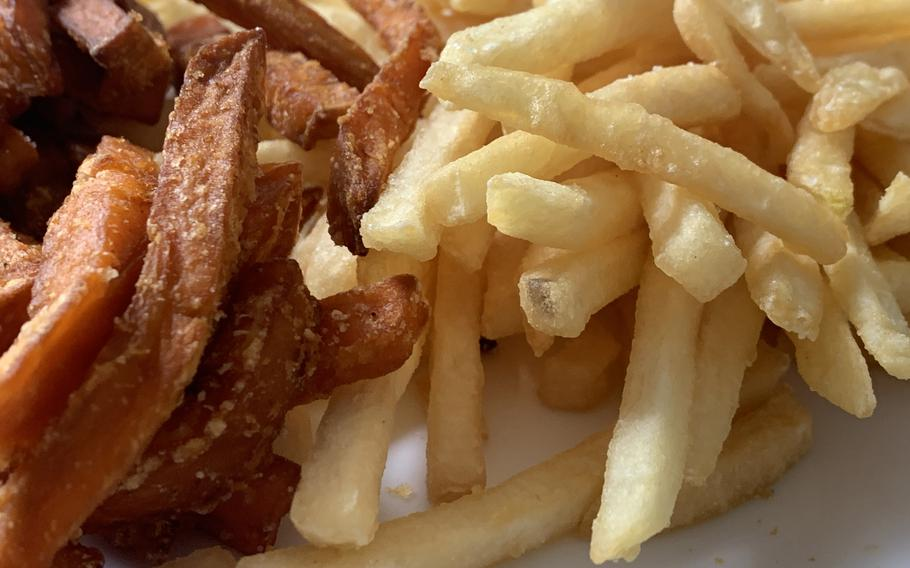 A mix of sweet potato and regular fries from Burgerme includes an example of the classic American standard cut fry, May 29, 2021.