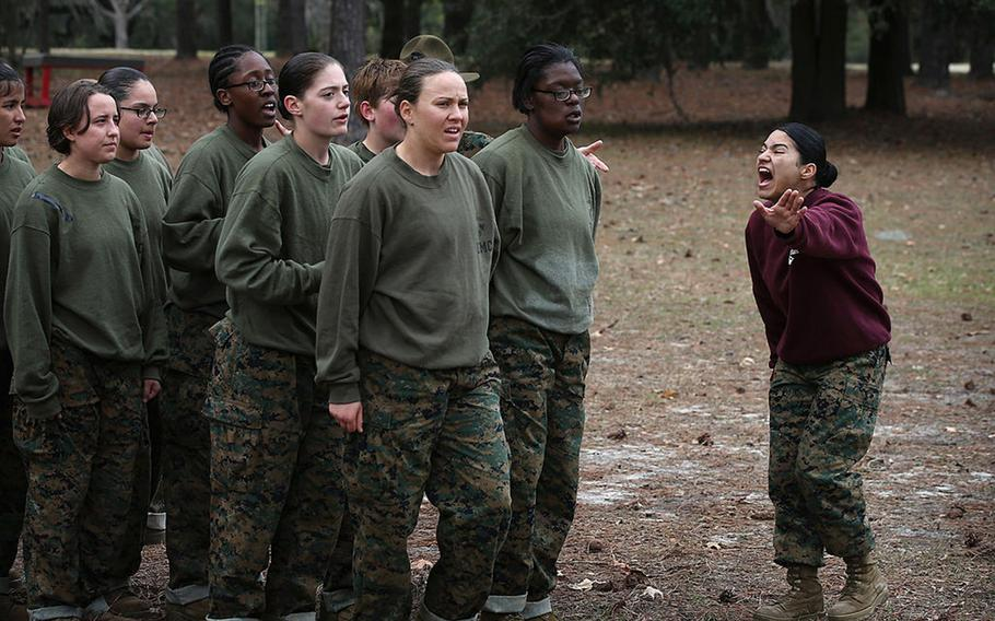 A drill instructor shouts instructions at her Marine recruits during training in boot camp February 27, 2013 at MCRD Parris Island, South Carolina.