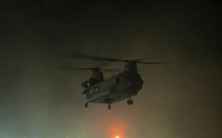 A helicopter carrying U.S. Embassy staff takes off from the embassy compound in Kabul, Afghanistan, in the early hours of Sunday, Aug. 15, 2021. Later that day, reports came in of the Taliban advancing on Kabul.