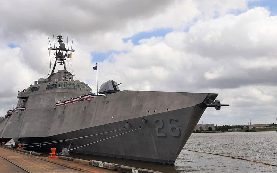 LCS-26 sits at a dock on the Mobile waterfront on May 20, 2021, prior to its commissioning as the USS Mobile.