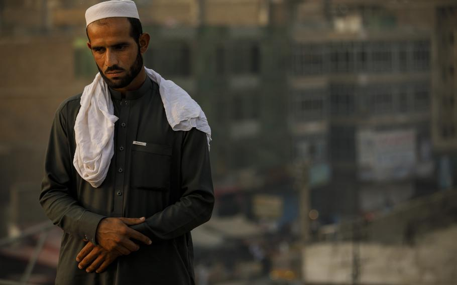 In a November, 2017 photo, Zafar Khan, 23, who lost six family members in an U.S. airstrike, poses for a portrait on a rooftop in Jalalabad, in Nangarhar Province, Afghanistan. The U.S. military said the Aug. 10 strike targeted militants who were observed loading weapons into a vehicle.