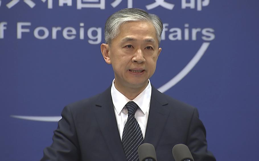 """Chinese Foreign Ministry spokesman Wang Wenbin speaks at a briefing in Beijing on Friday, June 11, 2021. China said on Friday that the United States and Australia were """"flexing their muscles """"with recent naval exercises in the South China Sea, underscoring Beijing's sensitivity to the strategic waterway it claims to be its own."""