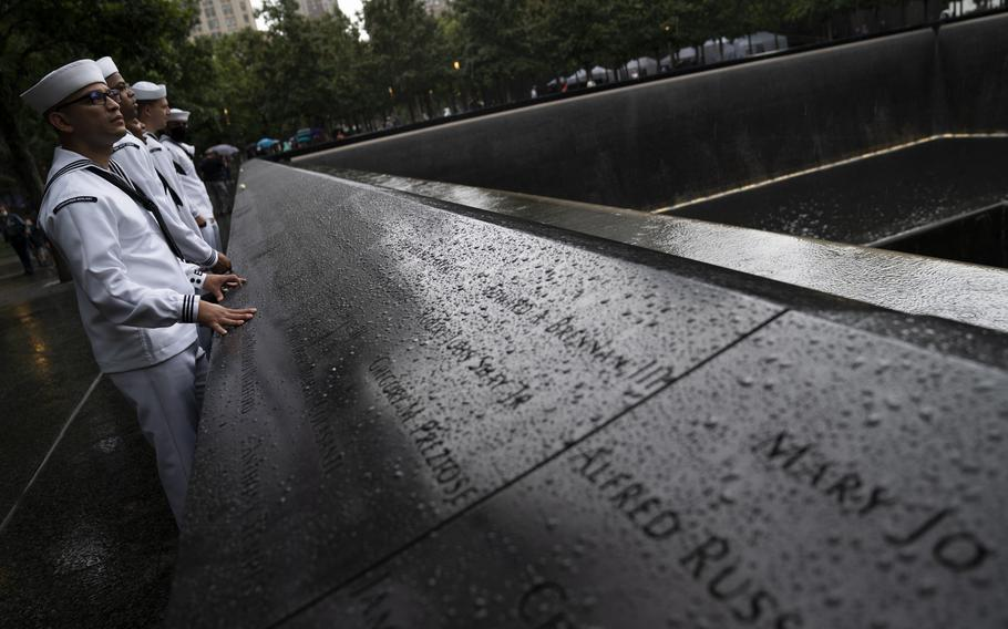 Military personnel on shore leave browse the north pool at the National September 11 Memorial & Museum, Thursday, Sept. 9, 2021, in New York.