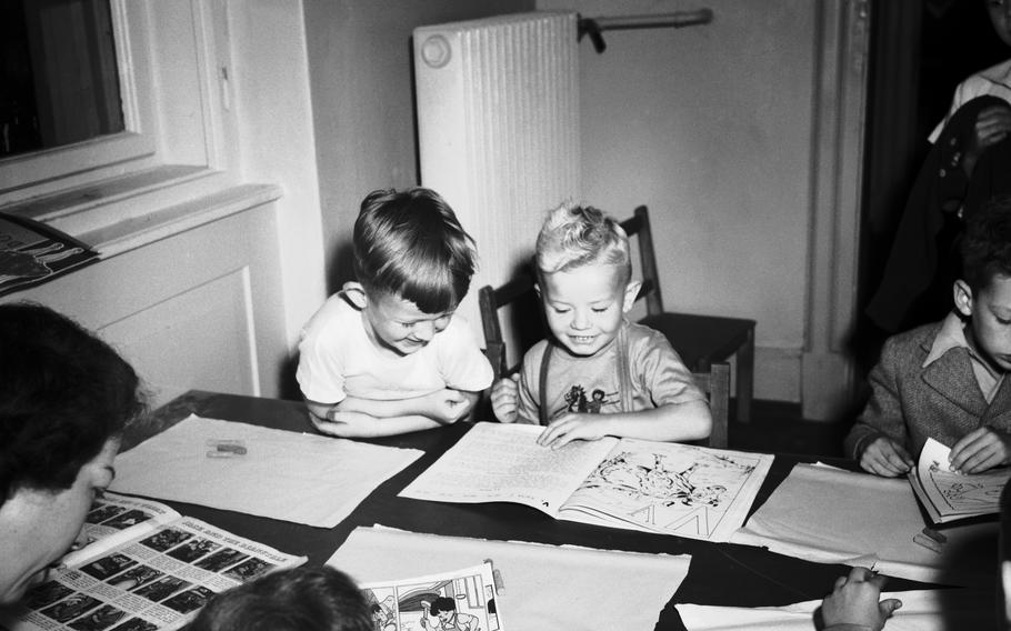 Johnny Walkmannm, left, and Billy Feeman are old hands at picture books, even though it's only their first day in Kindergarten at the Heidelberg dependents' school on Aug. 9, 1948.