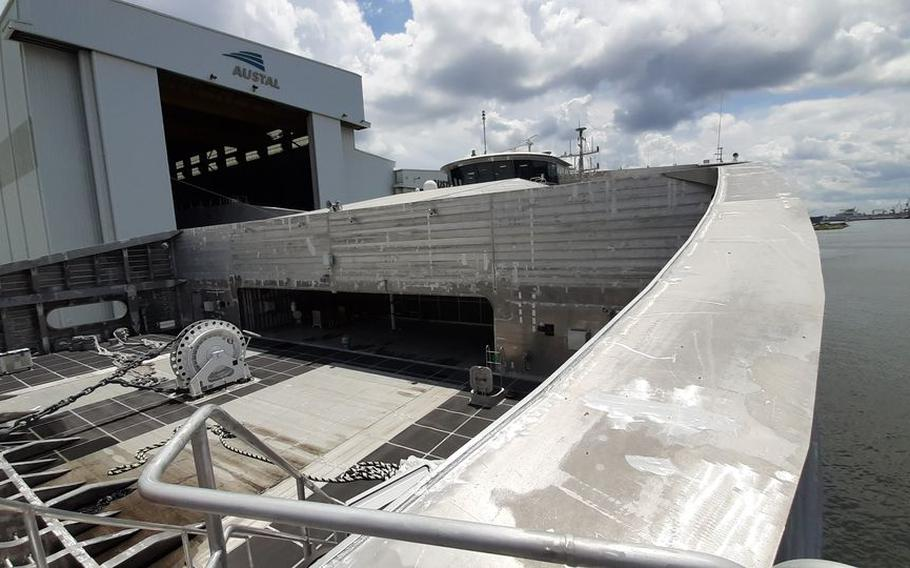 The bridge of EPF 12, the future USNS Newport, is seen from the bow of the ship as it is docked alongside Austal USA's shipyard in Mobile, Ala.