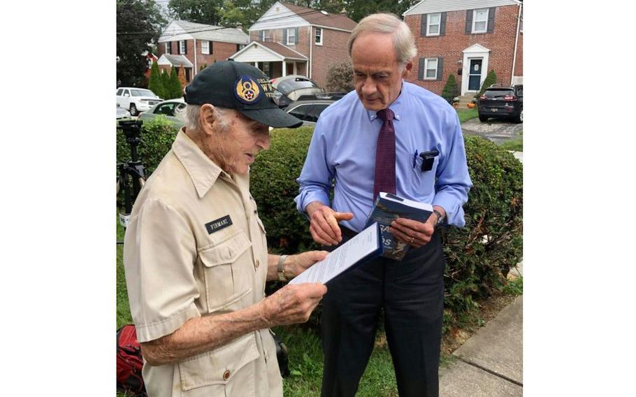 Sen.Tom Carperpresents about-to-be 100-year-old World War II veteran Ray Firmani with a letter signed by himself, Sen.Chris CoonsandU.S.Rep.Lisa Blunt Rochester, on Sept. 17, 2021 in Elsemere, Del.