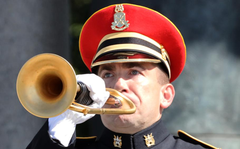 A bugler plays taps during a Memorial Day ceremony at the National World War II Memorial in Washington, D.C., May 31, 2021.