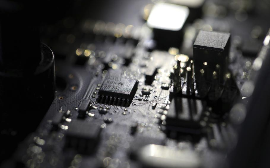 """This Feb 23, 2019 photo shows the inside of a computer. Three former U.S. intelligence and military operatives have agreed to pay nearly $1.7 million to resolve criminal charges that they provided sophisticated hacking technology to the United Arab Emirates. A charging document in federal court in Washington accuses them of helping develop """"advanced covert hacking systems for U.A.E. government agencies."""""""
