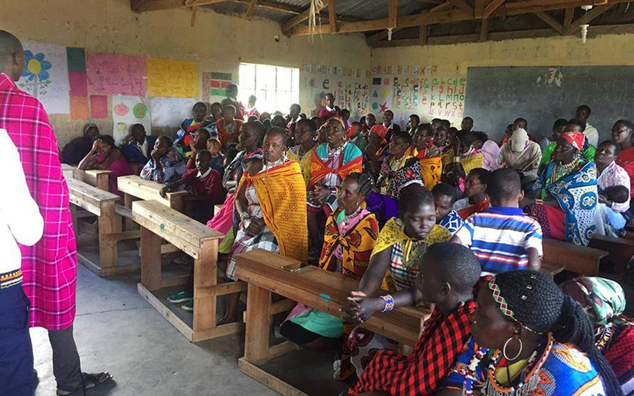 Maasai villagers gather in southern Kenya, where Air Force Tech. Sgt. Fariht Gomez first visited in 2018. Gomez is coordinating the donation of about two tons worth of supplies from U.S. airmen in England to help the village.