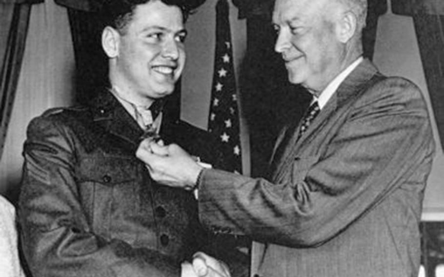 Marine Cpl. Duane Dewey receives the Medal of Honor from President Dwight Eisenhower at the White House, March 12, 1953.