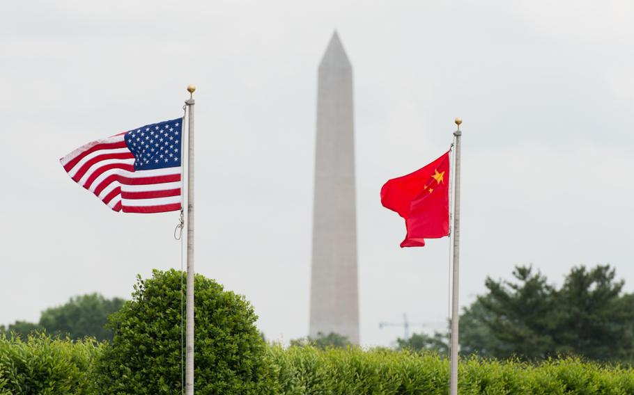 U.S. and Chinese flags fly before a full-honors welcome ceremony for a Chinese general outside the Pentagon in Arlington, Va., on May 15, 2014.