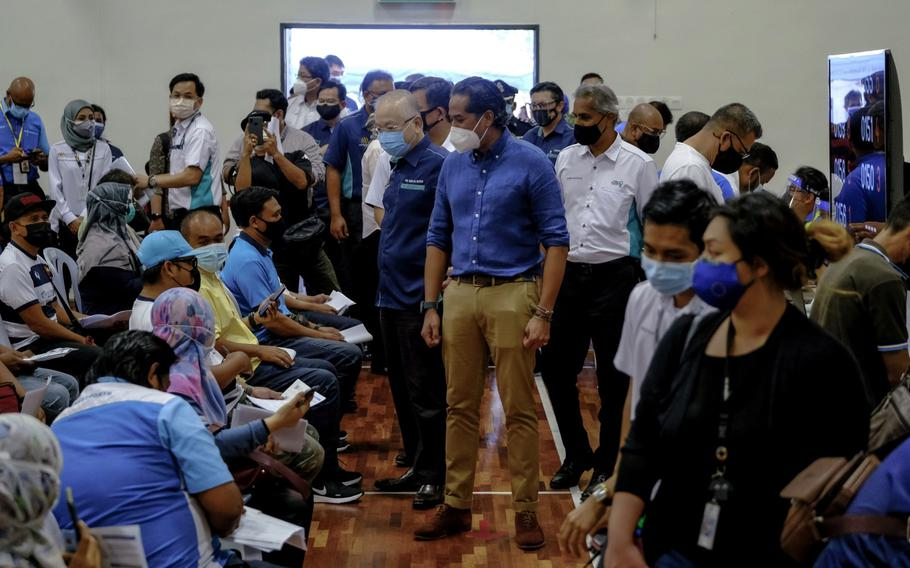 Khairy Jamaluddin, Malaysia's minister of science, technology and innovation, visits a COVID-19 vaccine program for sailors and port workers at the LPK Social and Recreation Club Multi-Purpose Hall Vaccinations Centre in Port Klang, Selangor, Malaysia, on June 25, 2021.
