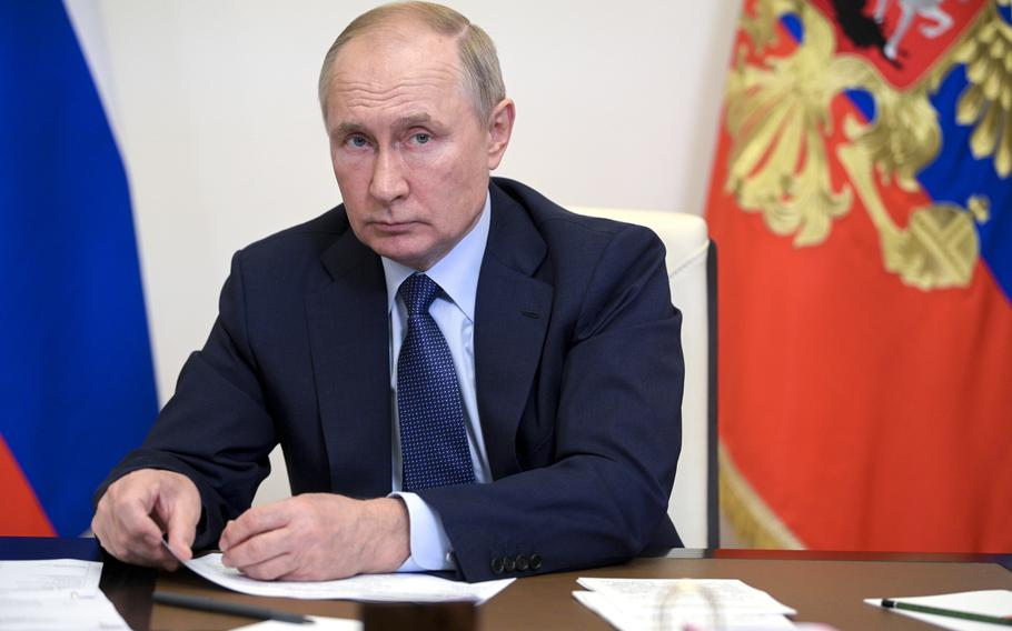 Russian President Vladimir Putin leads a cabinet meeting via video conference at the Novo-Ogaryovo residence outside Moscow, Russia, Tuesday, Oct. 5, 2021.