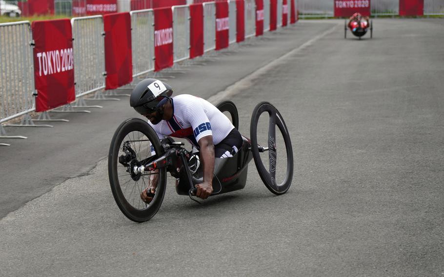 U.S. Army veteran Alfredo De los Santos rides a hand bike during a Paralympic time trial at Fuji International Speedway in Japan, Tuesday, Aug. 31, 2021