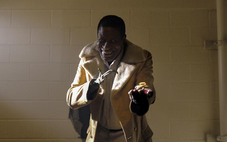 """This image released by Universal Pictures shows Michael Hargrove as Sherman Fields in a scene from """"Candyman,"""" directed by Nia DaCosta."""
