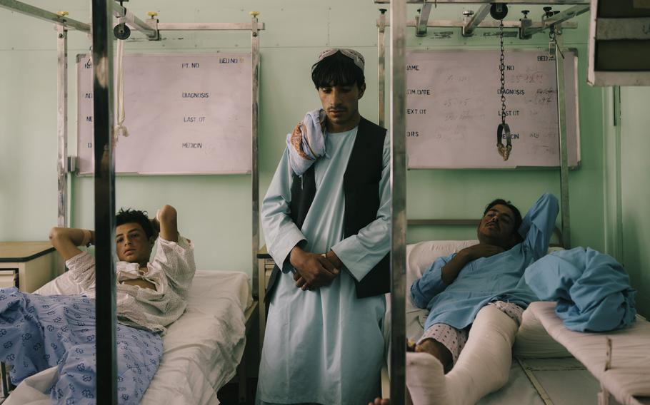 Policemen injured on the front lines recover in Kandahar's main hospital on July 31, just two weeks before the Taliban took control of the country.