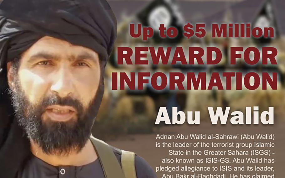 """A wanted posted shows Adnan Abu Walid al-Sahrawi, the leader of Islamic State in the Greater Sahara. French President Emmanuel Macron announced the death of al-Sahrawi on Wednesday, Sept. 15, 2021, calling the killing """"a major success"""" for the French military after more than eight years fighting extremists in the Sahel."""