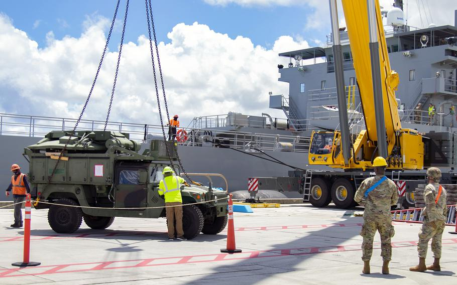 Soldiers and civilian contractors unload military vehicles from the Army vessel Lt. Gen. William B. Bunker at Naval Base Guam, July 10, 2021, in support of the Pacific Forager exercise.
