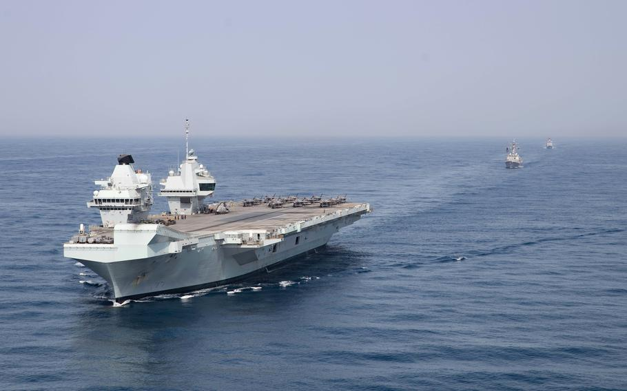The Royal Navy aircraft carrier HMS Queen Elizabeth, guided-missile destroyer USS Halsey and guided-missile cruiser USS Shiloh sail in the Gulf of Aden, Monday, July 12, 2021.