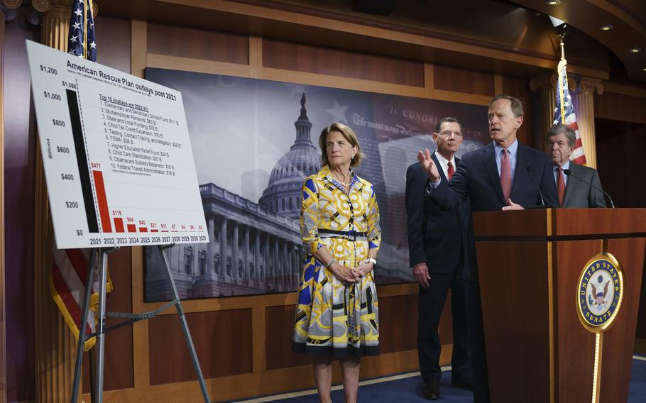 In this photo taken Thursday, May 27, 2021, Sen. Shelley Moore Capito, R-W.Va., the GOP's lead negotiator on a counteroffer to President Joe Biden's infrastructure plan, listens at left as she is joined at a news conference by, from left, Sen. John Barrasso, R-Wyo., Sen. Pat Toomey, R-Pa., chairman of the Senate Republican Conference, and Sen. Roy Blunt, R-Mo., at the Capitol in Washington.