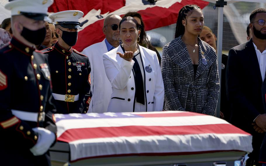 Colasa Pichardo, center, blows a kiss toward the casket of her daughter, Sgt. Johanny Rosario Pichardo, a U.S. Marine who was among 13 service members killed in a suicide bombing in Afghanistan, during a public wake in her hometown of Lawrence, Mass., Tuesday, Sept. 14, 2021.