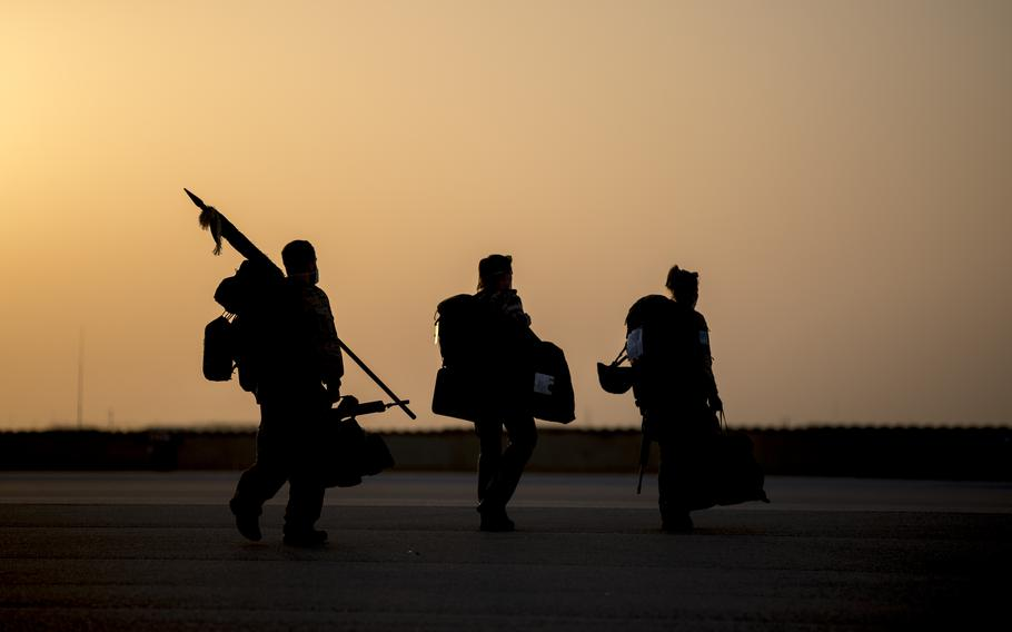 German service members head to the last Airbus A400M aircraft leaving the Mazar-e-Sharif airfield for home, as the German military mission in Afghanistan ends, June 29, 2021.