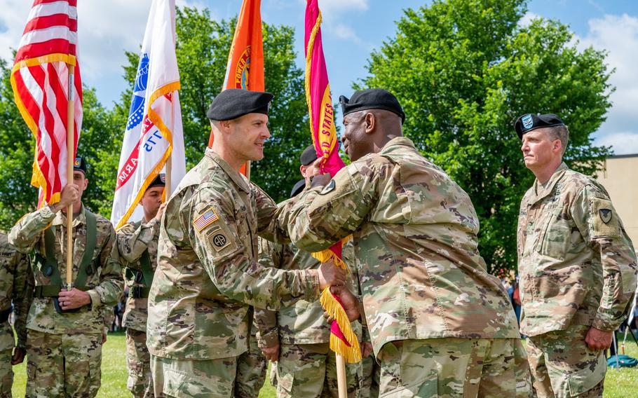 Col. Daniel Horn, left, assumes command of Tobyhanna Army Depot on June 28, 2021, as Maj. Gen. Mitchell Kilgo passes the flag.