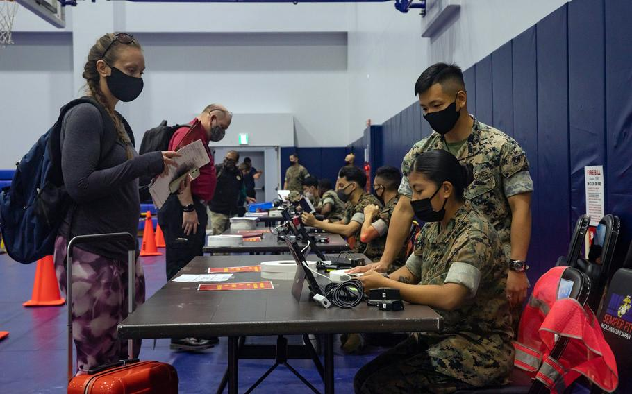 Family members and other nonessential personnel are processed through an evacuation control center during a mandatory three-day exercise at Marine Corps Air Station Iwakuni, Japan, Oct. 13, 2021.