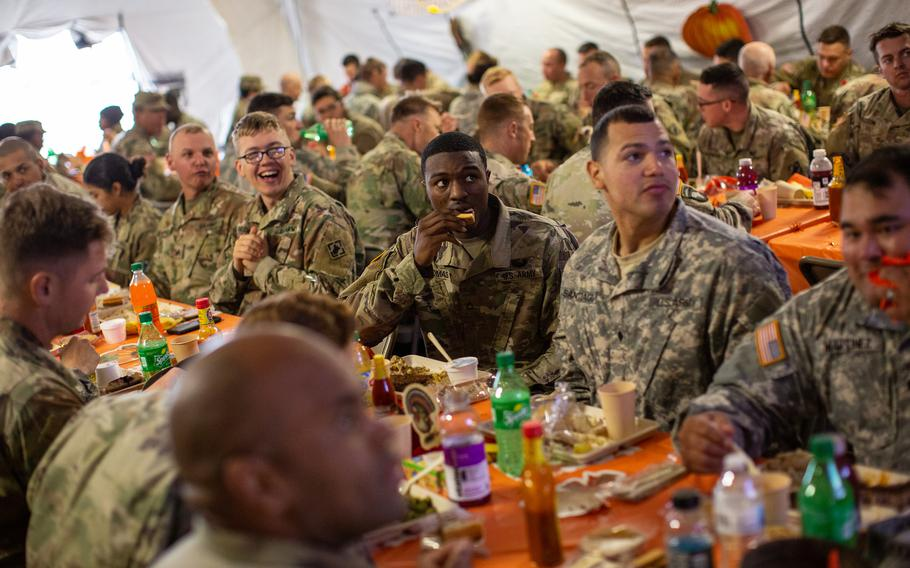 U.S. Army troops deployed to the U.S.-Mexico border eat a Thanksgiving meal at a base near the Donna-Rio Bravo International Bridge on Nov. 22, 2018, in Donna, Texas.